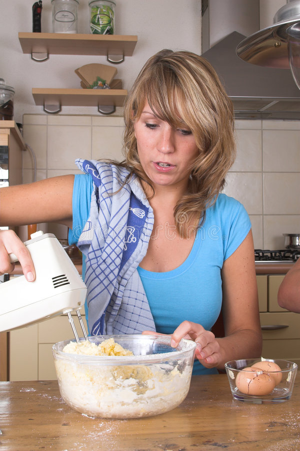 Download Mixing the cake dough stock image. Image of girl, dough - 1424521