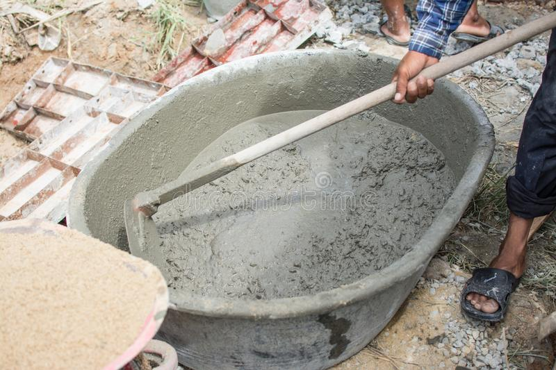 Mixing a cement in salver. For applying construction royalty free stock photo