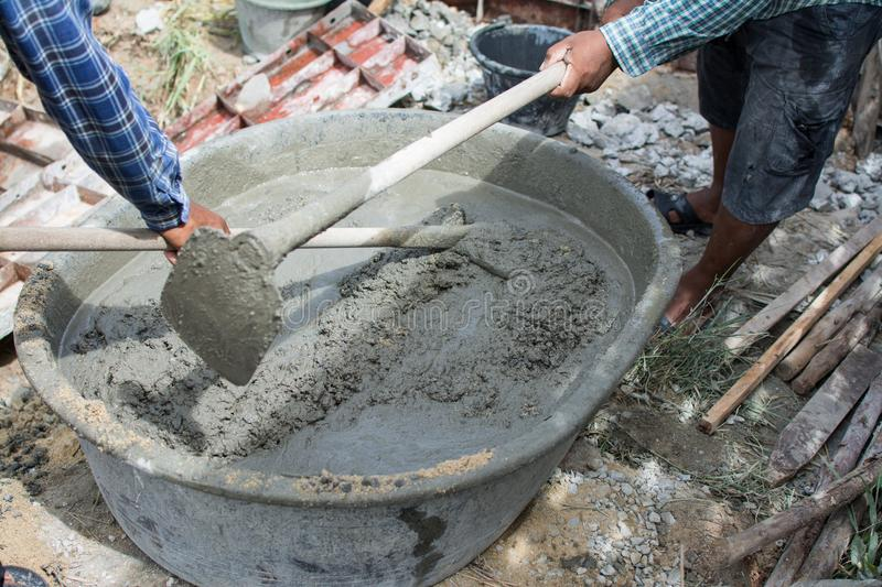 Mixing a cement in salver. For applying construction stock images