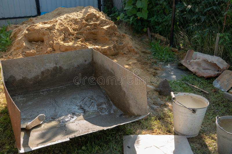 Mixing a cement in tank for applying construction. stock photo