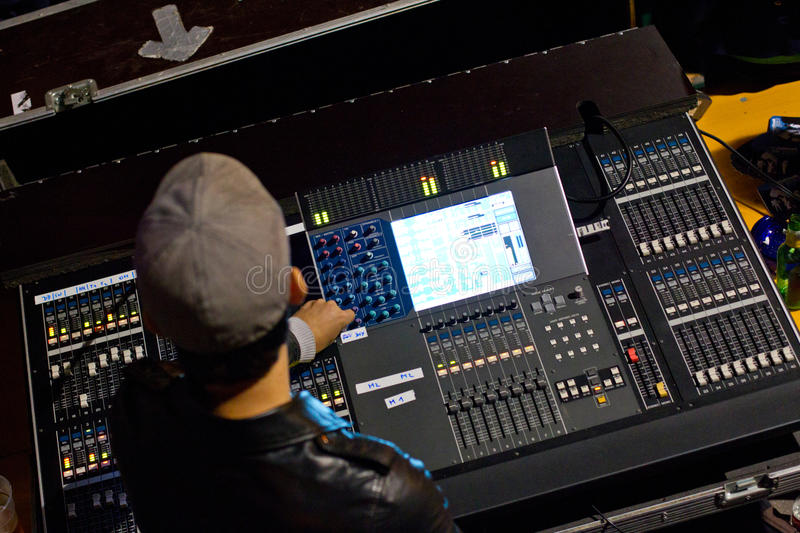 Mixing console. Every rock band needs a man who is working on the mixing console royalty free stock photo