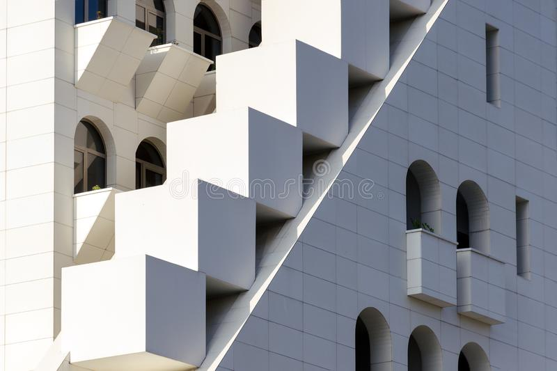 Mixing of forms and shapes, layering in modern architecture - part of facade building, unusual geometrical exterior. Complex structure. Batumi, Georgia royalty free stock photo