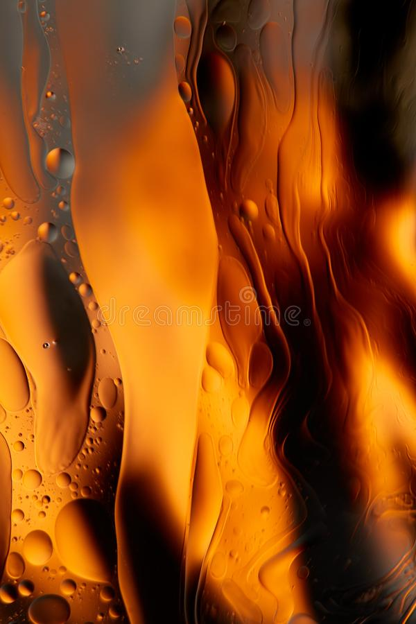 Mixing water and oil, beautiful color abstract background based on red and yellow circles and ovals, macro abstraction royalty free stock images
