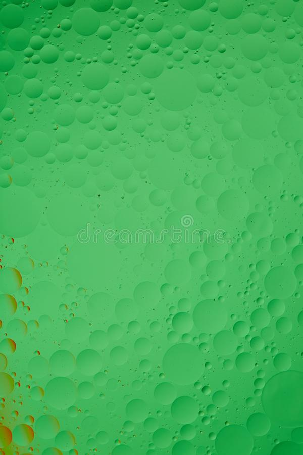 Mixing water and oil, beautiful color abstract background based on red and yellow circles and ovals, macro abstraction stock photos