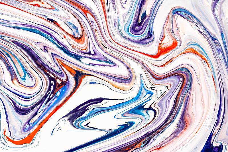 Mixture of acrylic paints. Blue, purple and coral red mixed acrylic paints. Liquid marble texture. Applicable for design royalty free stock photography