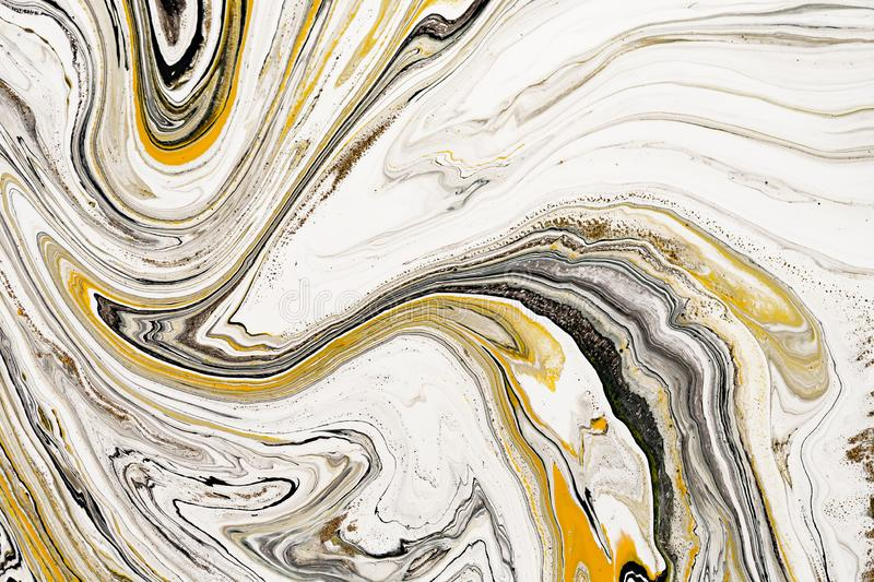 Mixture of acrylic paints. Modern artwork. Yellow and black mixed acrylic paints. Liquid marble texture. Applicable for. Design packaging, labels, business royalty free stock photo
