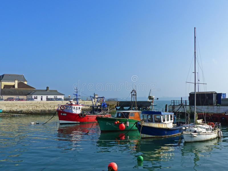 A mixture of boats on their moorings in the small harbour in the so called proud Cobh of Cork in Ireland on a beautiful day. stock image