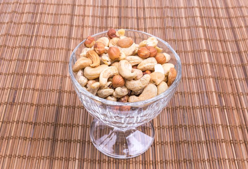 A mixture of cashew nuts, almonds, hazelnuts in a wine glass stock photos