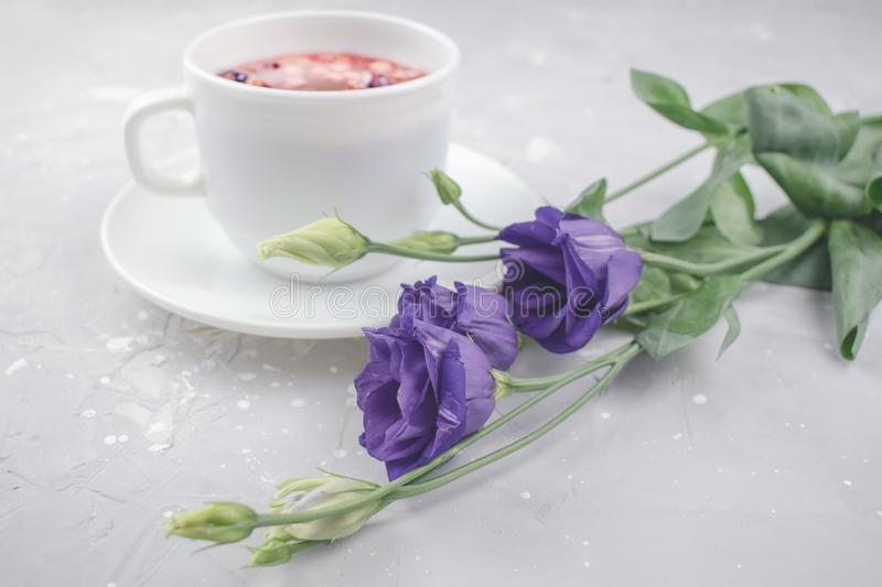 Mixture herbal floral tea with petals, dry berries and fruits. healthy drink. Hot fruit, healthy tea in a white mug.  royalty free stock images