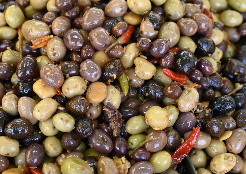 Mixture of many types of olives on sale in the Cours Saleya Market in the old town of Nice, France royalty free stock image