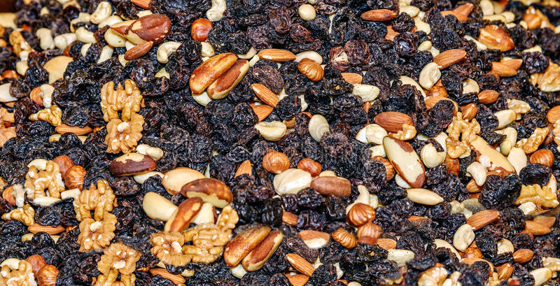 Mixture of nuts with raisins. Brazilian, walnut, cashew, hazelnut, almonds. Food for students royalty free stock images