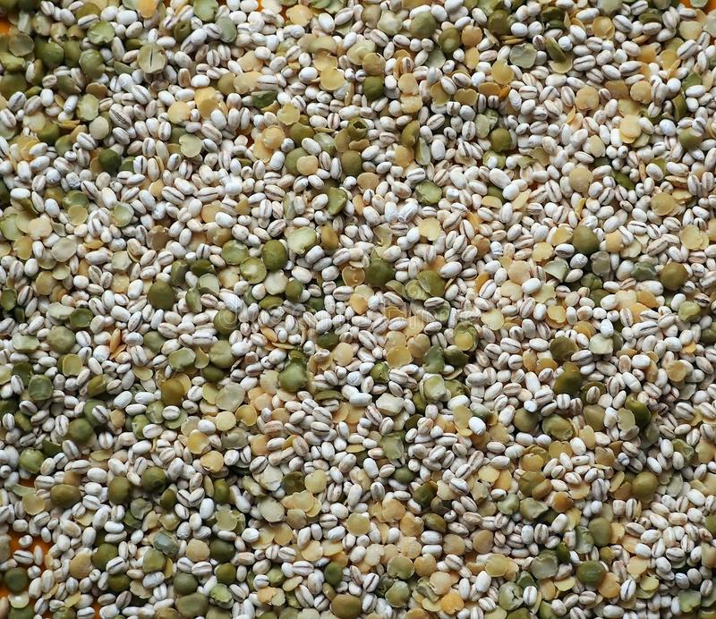 Mixture of pearl barley with peas and decorticated yellow lentils , ready for a healthy soup or a cold summer dish stock image