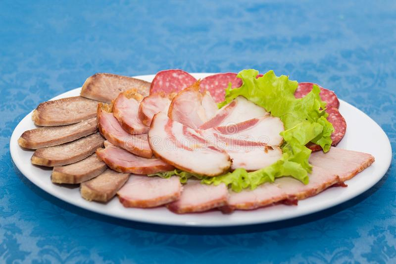 Mixture of sliced meat, sausage and ham royalty free stock images