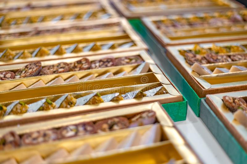 A mixture of various Indian sweets packed in a box. Peda, laddu, mithai, diwali sweets stock photography