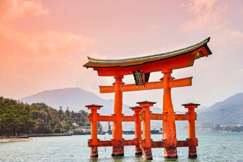Miyajima, Hiroshima, Japan at the floating gate of Itsukushima S. Hrine. gate sign reads Itsukushima Shrine royalty free stock photos