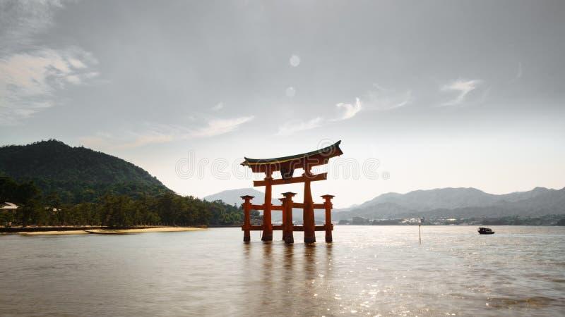 Miyajima island and Floating Torii gate in Japan. backlit. Wide angle backlit of Miyajima island with Floating Torii gate, Japan stock images