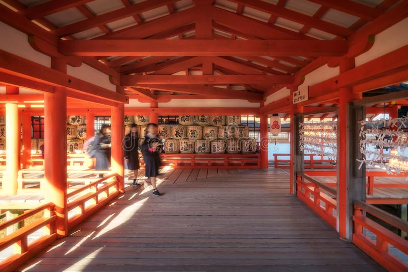 East Corridor at Itsukushima Shrine on Miyajima Island in Japan with sake barrels in the background. Miyajima Island, Hiroshima, Japan -The East Corridor extends stock photography