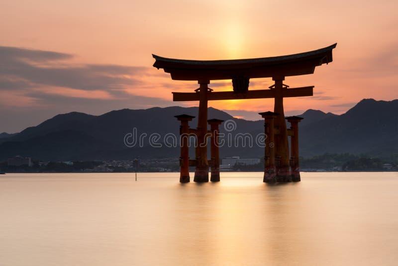 Miyajima island - Silhouette of the  Itsukushima Floating Torii Gate at sunset. Miyajima island near Hiroshima, Japan - Silhouette of the  Itsukushima Floating stock photo