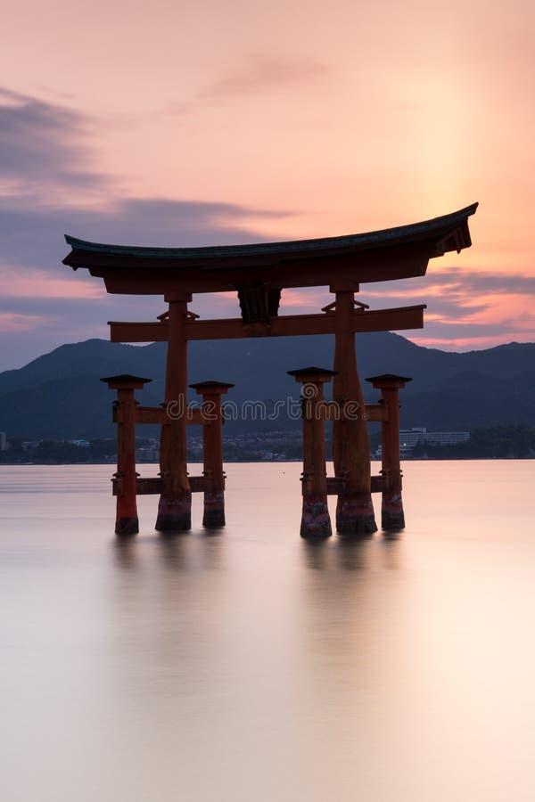 Miyajima island - Silhouette of the  Itsukushima Floating Torii Gate at sunset. Miyajima island near Hiroshima, Japan - Silhouette of the  Itsukushima Floating royalty free stock photos