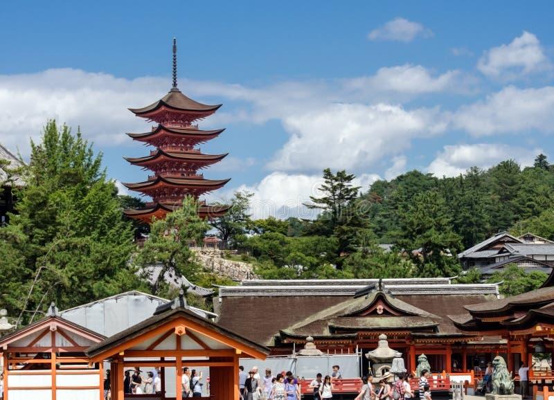 Torists and Five-storied Pagoda (Gojunoto) at Miyajima island. Japan stock photos