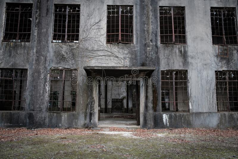 MIYAJIMA, JAPAN - FEB 04, 2018: Abandoned poison factory of war in Miyajima Rabbit island. At daytime royalty free stock photo