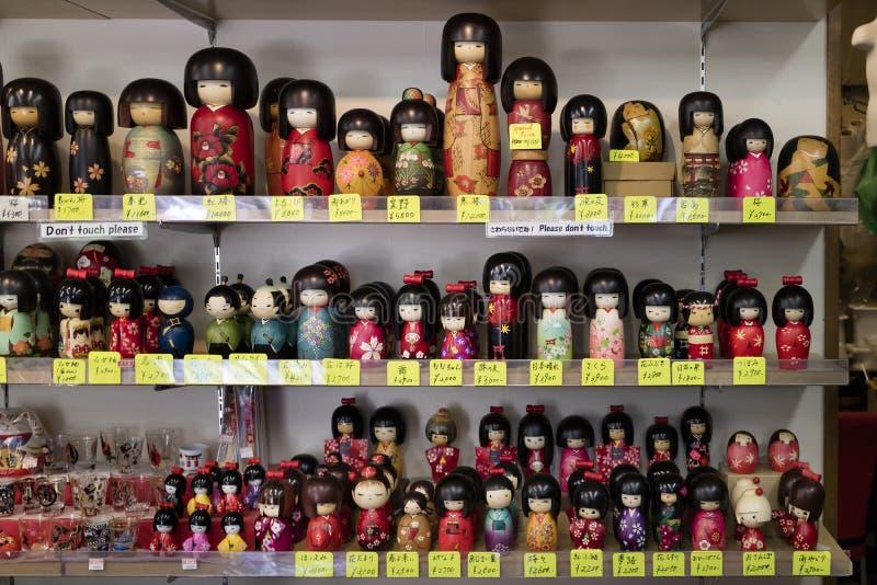 Miyajima, Japan - May 26, 2017: Traditional wooden Japanese kokeshi dolls for sale as souvenir royalty free stock photos