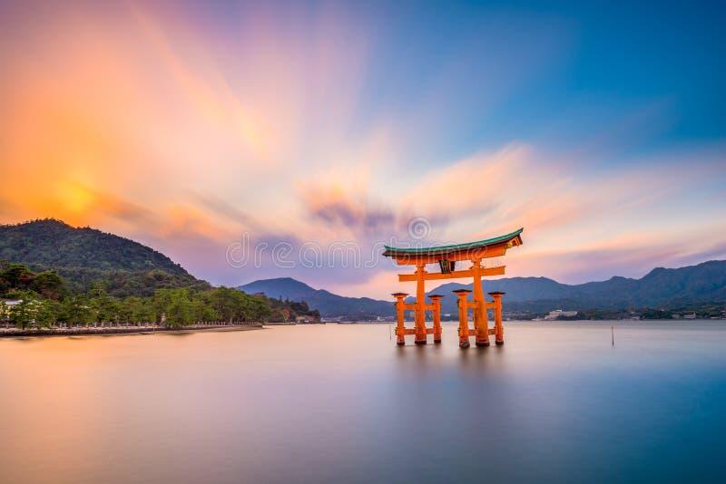 Miyajima Shrine Gate. Miyajima, Hiroshima, Japan at the floating gate of Itsukushima Shrine. (gate sign reads Itsukushima Shrine stock photography