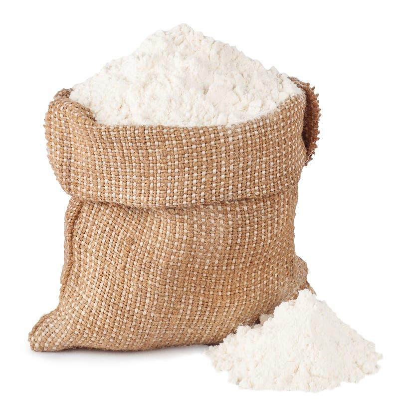 Mjöl i säckvävsäck och hög som isoleras på vit arkivbild