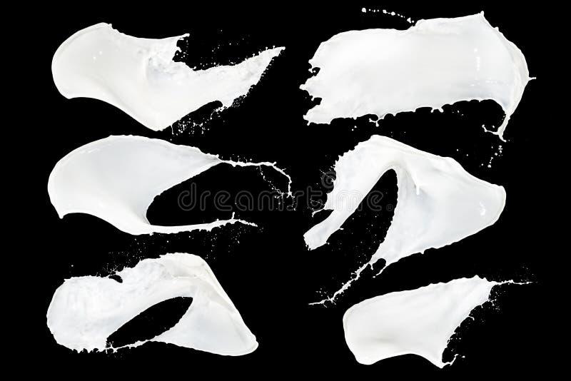 Mjölka färgstänksamlingen fotografering för bildbyråer