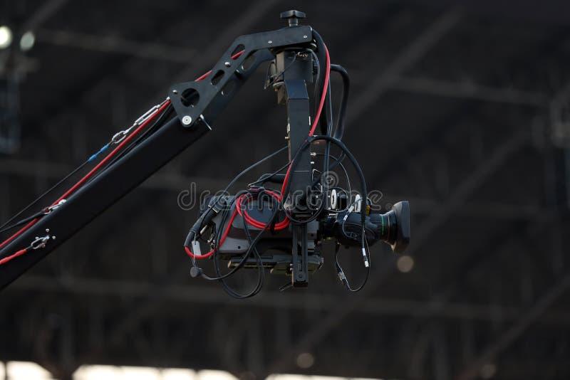 Mjuk fokus och oskarpt av yrkesmässig kameraman och videokameran arkivbild