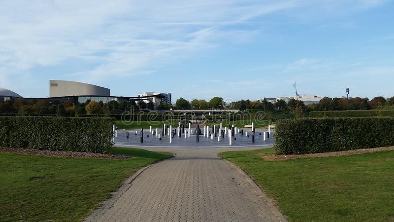 MK Rose looking along Midsummer Line. MK Rose memorial with Theatre and Xscape building in background. Milton Keynes stock images