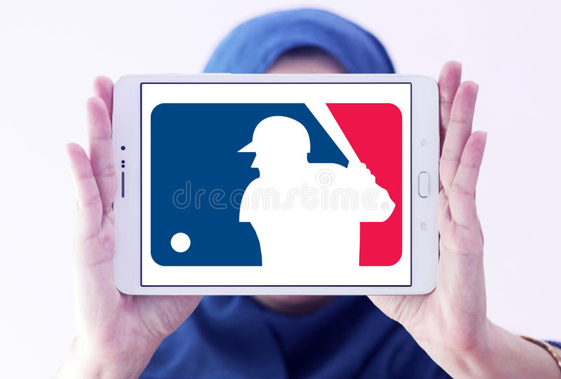 MLB , Major League Baseball logo. Logo of american MLB , Major League Baseball on samsung tablet holded by arab muslim woman stock photography
