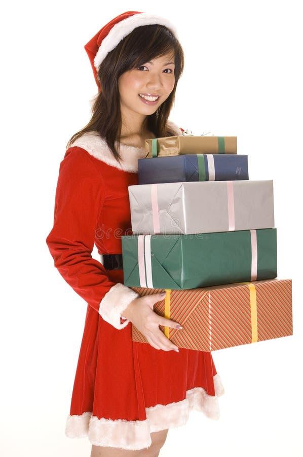 Mlle Santa et présents 2 photos stock