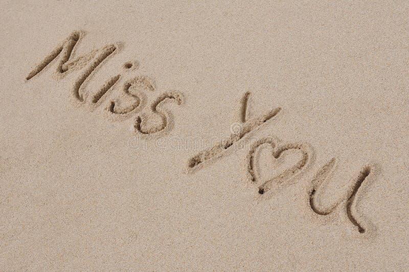 Mlle You Written en sable photographie stock libre de droits