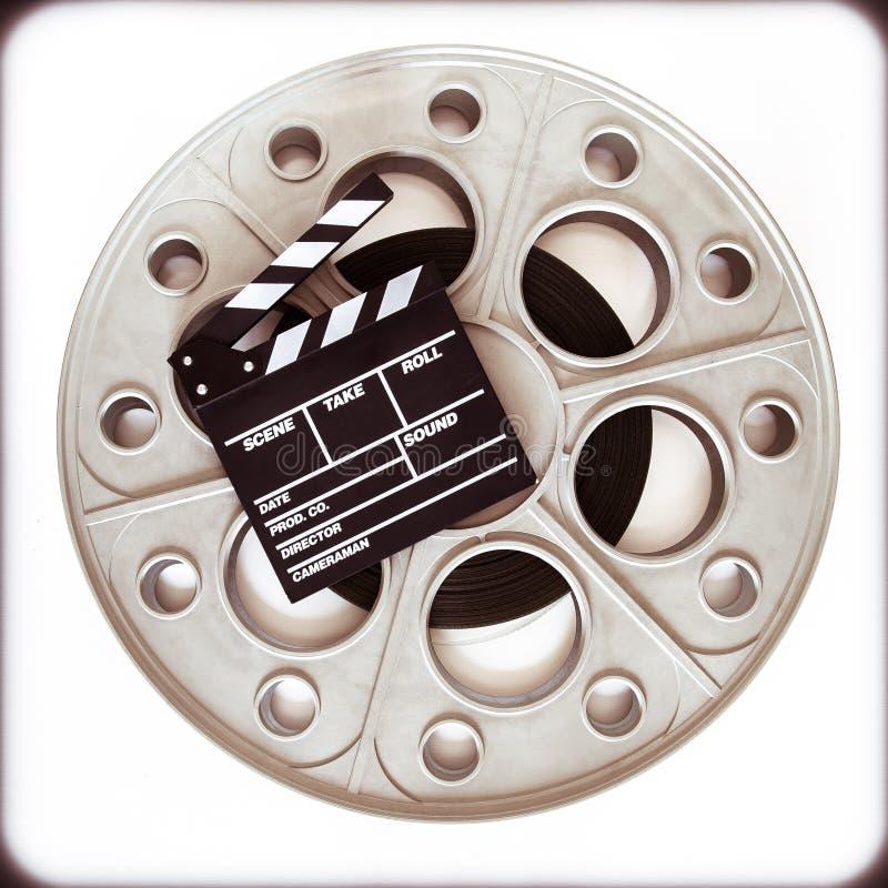 35mm电影放映机的原始的老电影卷轴有拍板蟒蛇的 库存图片
