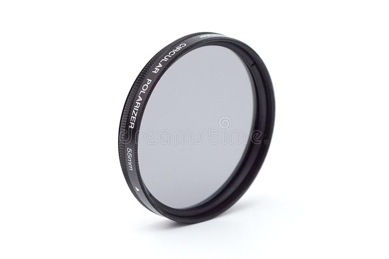 Circular polarizer filter. A 55mm diameter CPL filter isolated on white royalty free stock image