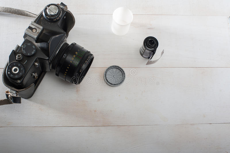 35 mm film camera and black and white film. 35 mm film camera with film stock images