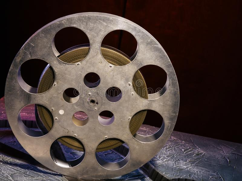 35 mm film reel with dramatic lighting on a dark background royalty free stock images