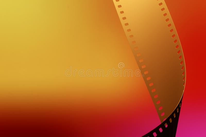 35 mm Motion Picture Film. Camera negative film. Selective focus on film perforation. Unprocessed color motion picture film. Industry symbol for shooting process stock photography