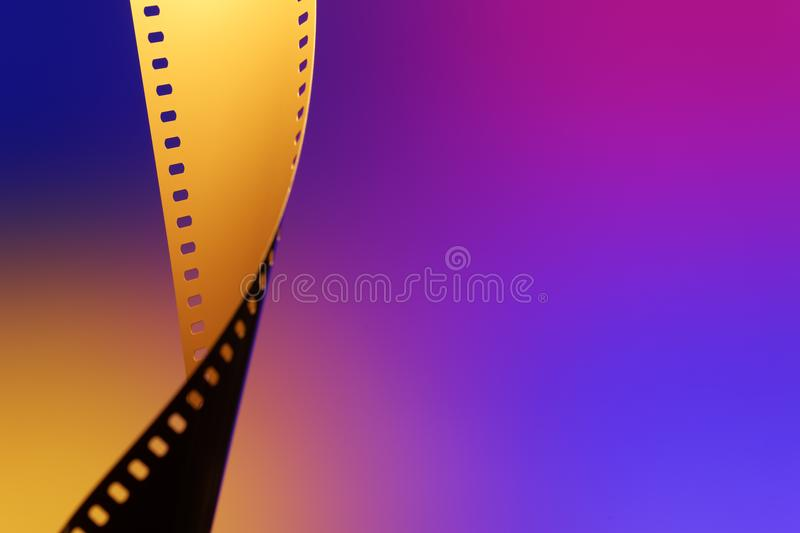 35 mm Motion Picture Film. Camera negative film. Selective focus on film perforation. Unprocessed color motion picture film. Industry symbol for shooting process royalty free stock images