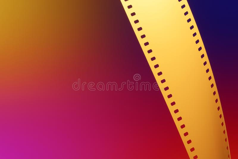 35 mm Motion Picture Film. Camera negative film. Selective focus on film perforation. Unprocessed color motion picture film. Industry symbol for shooting process royalty free stock photo