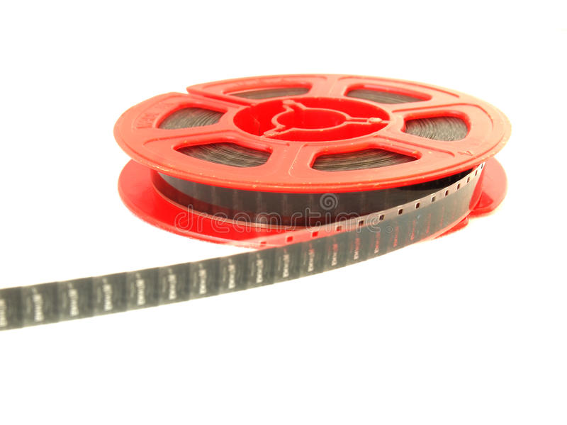 8 mm movie film reel / isolated white. 8 mm movie film reel , isolated white royalty free stock photos