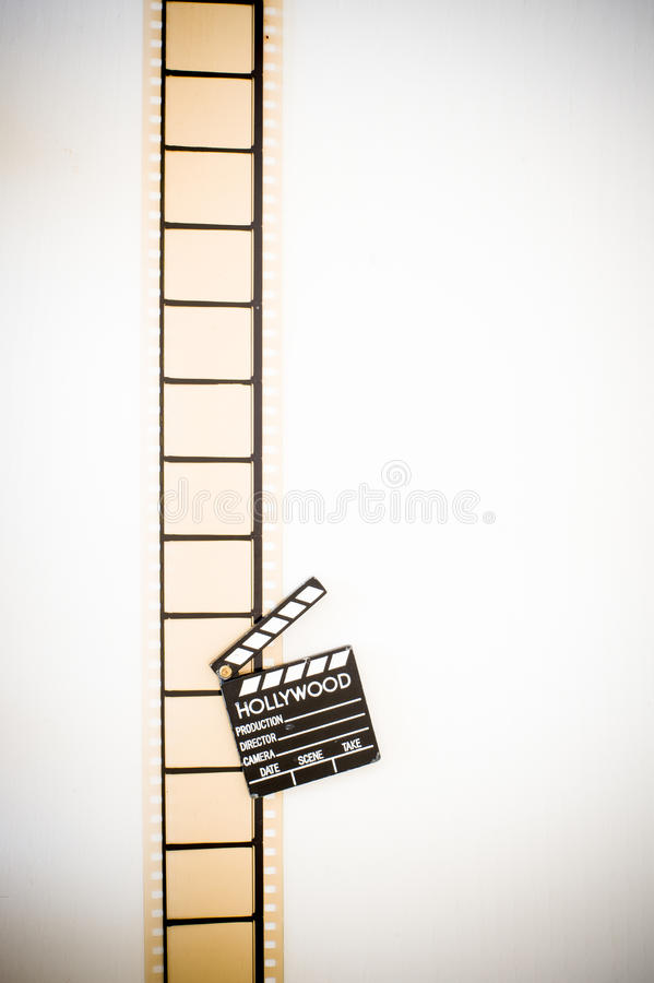 35mm movie filmstrip blank frames reel with clapper board. Vintage color effect vertical stock images
