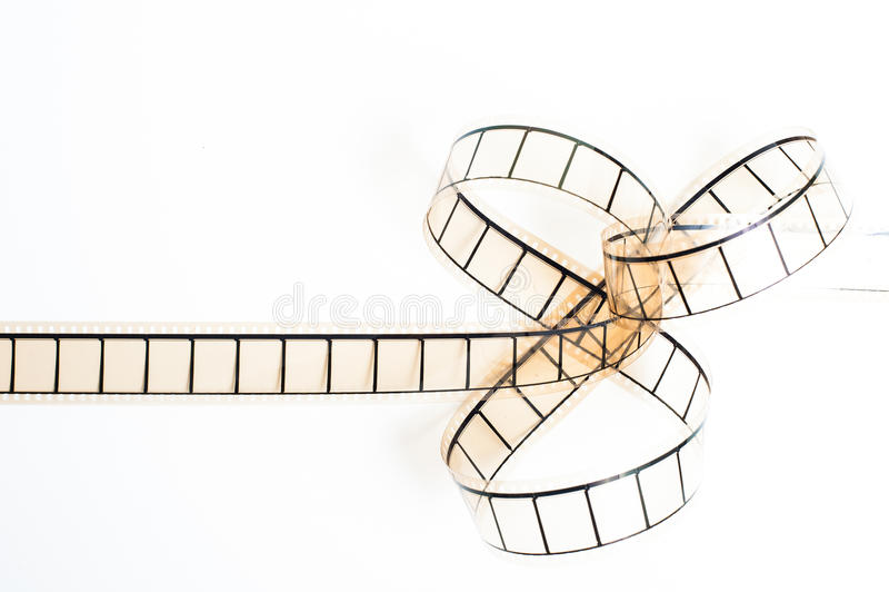 35mm movie filmstrip, film bow on white background stock illustration