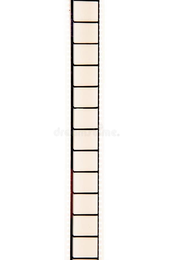 35 mm opróżniają pionowo filmstrip odizolowywającego filmu białego tło zdjęcie royalty free
