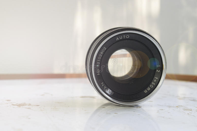 50mm vintage lens with a flare and soft lights in a grunge table royalty free stock photo