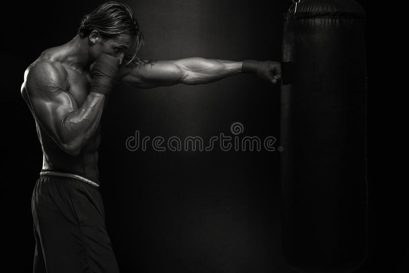 MMA Fighter Practicing With Boxing Bag royalty free stock photo