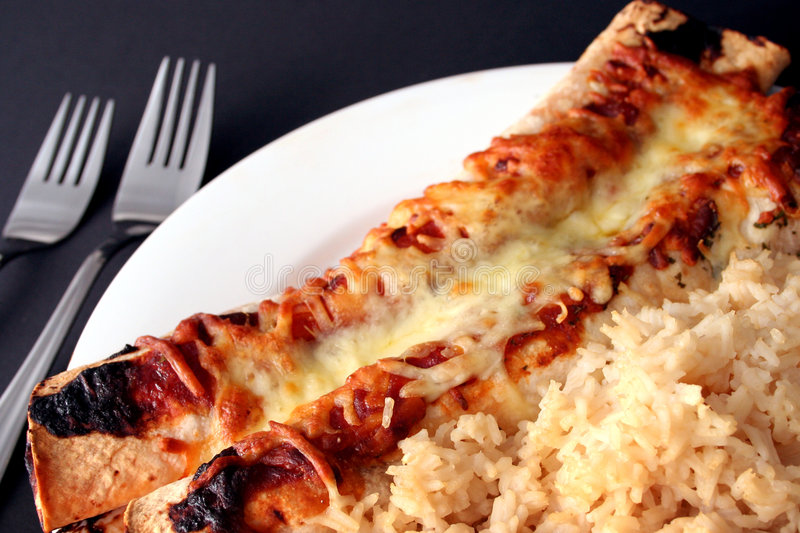 Download Mmmm enchiladas! stock image. Image of cheese, plate, sauce - 466139