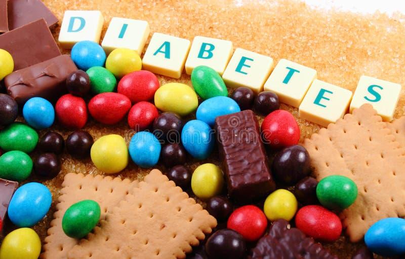 Mnóstwo cukierki, brown cukier i słowo cukrzyce, niezdrowy jedzenie zdjęcie stock