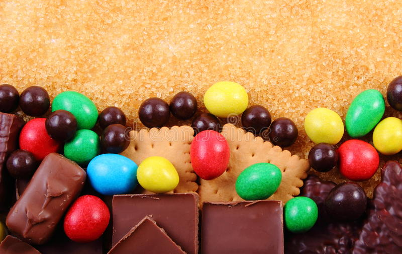 Download Mnóstwo Trzcina Brown Cukier I Cukierki, Niezdrowy Jedzenie Obraz Stock - Obraz złożonej z kolorowy, ciastka: 57656755